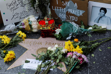 A crown, flowers and pictures are shown placed at Aretha Franklins star on Hollywood Boulevard in Los Angeles