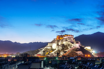the Potala Palace and pagodas in the sunrise glow, Lhasa, Tibet