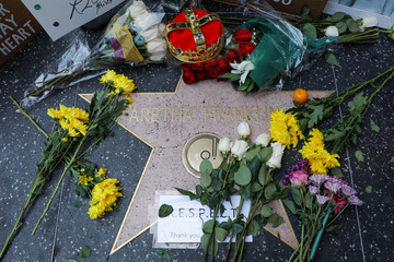 A crown, flowers and pictures are shown placed at Aretha Franklin's star on Hollywood Boulevard in Los Angeles