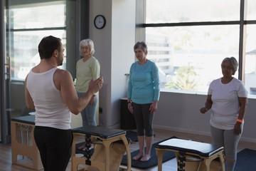 Trainer instructing group of senior women
