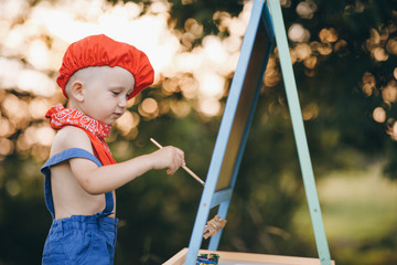 Child Boy Drawing Picture Outdoors in Summer park