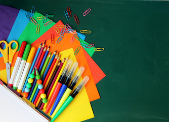 school supplies on the chalkboard background / school