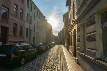 street with old houses in rostock - backlight scene