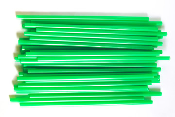 Drinking straws for party on gray background. Top view of colorful paper disposable eco-friendly straws for summer cocktails. Drinking paper colorful straws for summer cocktails.
