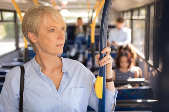 Female commuter travelling in bus