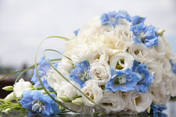 beautiful bouquet of white and blue flowers