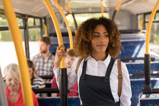 Female commuter travelling in modern bus