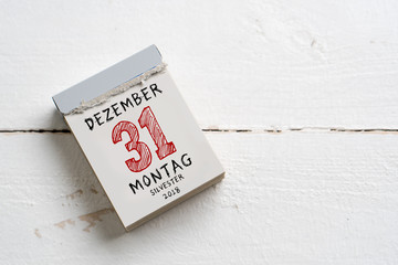 tear-off calendar with the 31st of december 2018, Silvester on top on a wooden surface