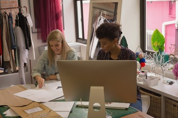 Fashion designers working on desk