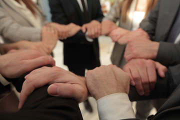 background image of business team folded their hands forming a circle