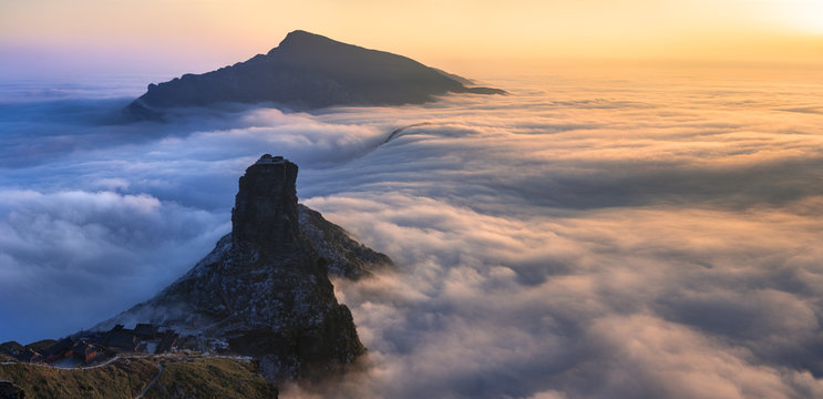 Fanjingshan, Sea of Clouds, Sunset above the Clouds at Mount Fanjing Nature Reserve - Guizhou Province, China. Summit in the clouds. UNESCO World Heritage List, China National Parks