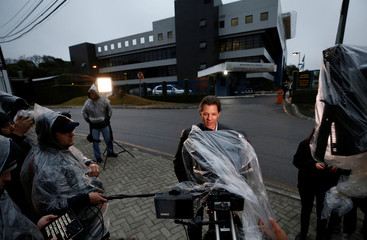 Former Sao Paulo Mayor Fernando Haddad, who was registered as Brazil's former President Luiz Inacio Lula da Silva vice-president candidate records a campaign video outside the Federal Police headquarters in Curitiba
