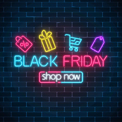 Glowing neon sign of black friday sale with shopping symbols. Seasonal sale web banner. Black friday light signboard.