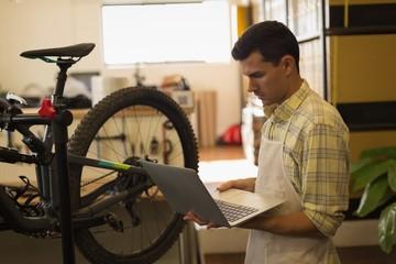 Man using laptop on workshop