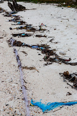 Large amounts of plastic and other rubbish washed up on the high tide line on a remote tropical beach