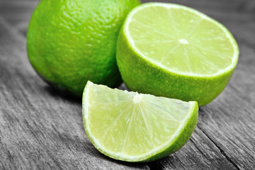 Lime with half on a gray rustic wood table