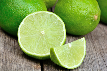 Freshness limes on a wood table