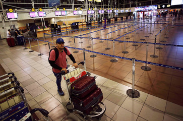 A passenger wait for his flight at the departures area of Latam airlines inside the international airport in Santiago