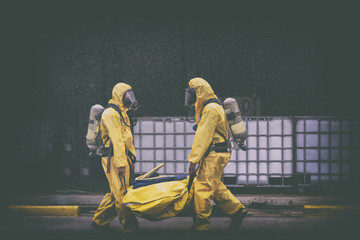 chemical spill pollution response team in action recovery stop spill of the chemical spill pollution at factory . Hazard emergency response concept