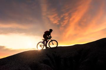 Mountain Bike cyclist on top of a mountain .