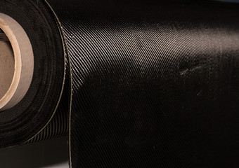 Carbon fiber rolled weave composite material