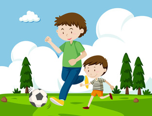 A father and son playing football