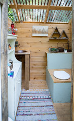 Outdoor composting toilet stall at a glamping site