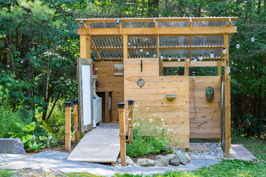 Outdoor shower and composting toilet stall at a glamping site