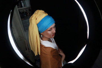 """Makeup artist He Yuhong poses during a photo shoot following her transformation into the """"Girl with a Pearl Earring"""" at her house in Chongqing"""