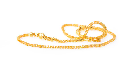 Golden necklace isolated on white background