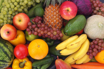 Mixed fresh colorful fruits and vegetables as healthy and natural food background