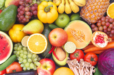 Mixed fresh colorful fruits and vegetables as healthy and natural food with vitamins