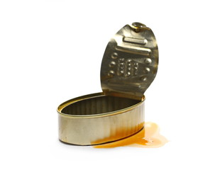 Opened empty fish tin can with spilled sauce, isolated on white background