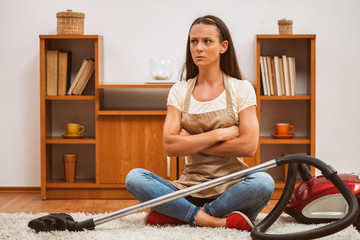 Young woman has to clean the house. She is lazy.