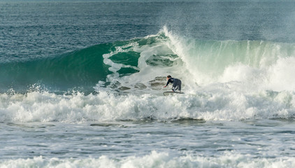 Surfer closing in on barrel, Fistral, Newquay, Cornwall