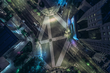Aerial drone view on city intersection during night