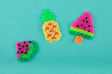 Set of three flat plastic fruits made of thermo mosaic