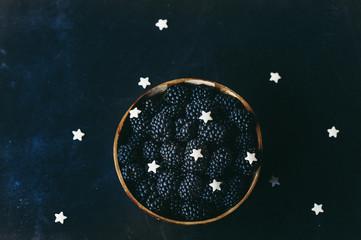 Blackberries in a bowl on dark background