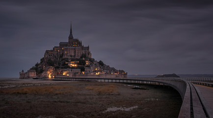Beautiful night view of famous illuminated historic Le Mont Saint-Michel tidal island, France