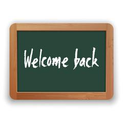 Vector Welcome Back Phrase on Green Blackboard