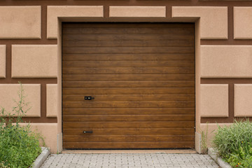 garage gates for car in house building facade