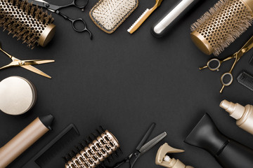 Hairdresser tools on black background with copy space in center Wall mural