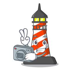 Photographer lighthouse on the beach mascot