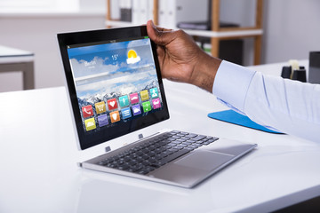 Businessman Attaching Digital Tablet To Keyboard