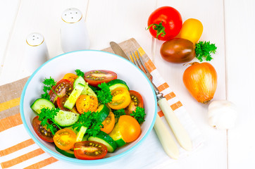 Dietary salad from tomatoes and cucumbers