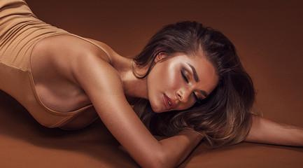 Beauty portrait of sensual brunette girl.