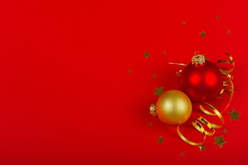 Christmas Baubles and Ribbon on the Red Background