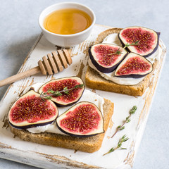 Toasted whole wheat bread with figs, ricotta (cream cheese), thyme, honey