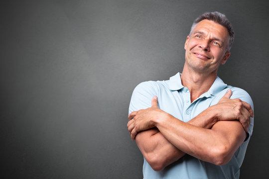 Portrait Of A Mature Man Hugging Himself