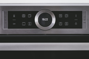 Steel modern touching panel of house electric oven.